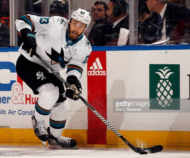 Barclay Goodrow of the San Jose Sharks skates with the puck against the Florida Panthers at the BBT Center on December 8 2019 in Sunrise Florida