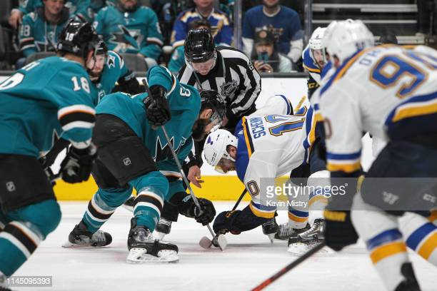 Barclay Goodrow of the San Jose Sharks takes a faceoff against Brayden Schenn of the St Louis Blues in Game Five of the Western Conference Final...
