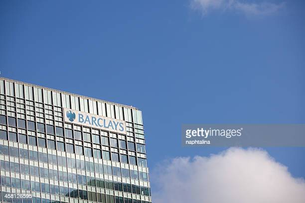 barclays bank in canary wharf, london - barclays brand name stock photos and pictures