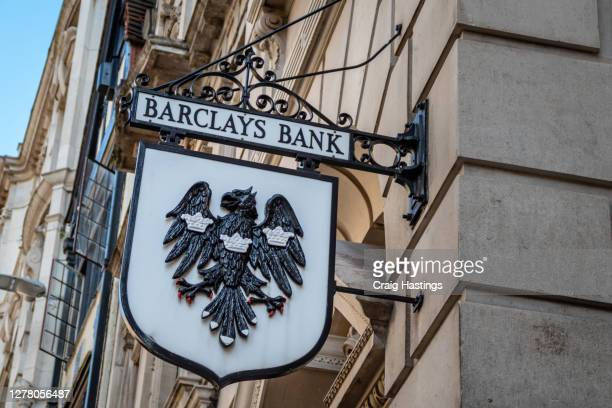 barclays bank old fashioned logo - barclays brand name stock pictures, royalty-free photos & images