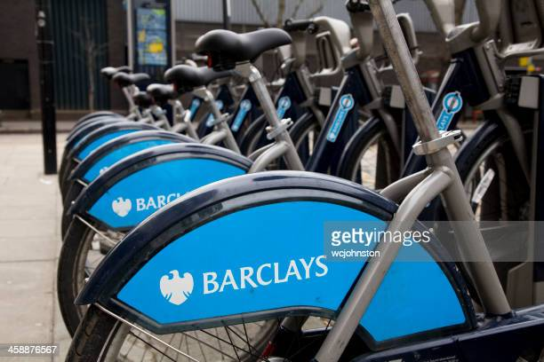 barclays bank sponsored boris bikes in london - barclays brand name stock photos and pictures