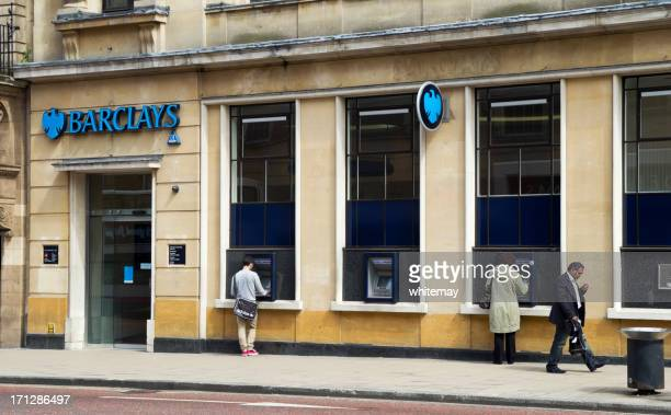 barclays bank with atms in use - barclays brand name stock photos and pictures