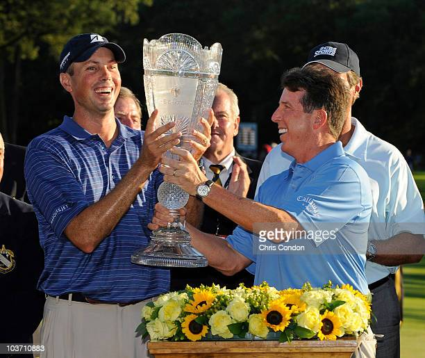 Barclays CEO Bob Diamond hands Matt Kuchar the tournament trophy after Kuchar wins The Barclays at Ridgewood Country Club on August 29 2010 in...