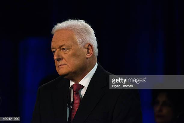 Barclay's Chairman John McFarlane listens to CNBC's Becky Quick during the Clinton Global Initiative Annual Meeting at the Sheraton Hotel and Towers...