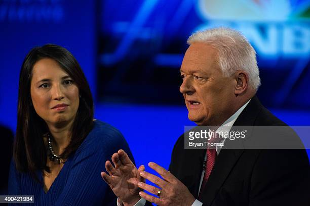 Barclay's Chairman John McFarlane right talks while UNICEF's Senior Advisor on Innovation to the Executive Director Erica Kochi left listens during...