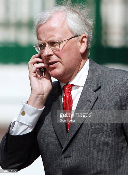 Barclays Chief Executive Officer John Varley speaks on his mobile phone as he leaves the company's annual general meeting at the Queen Elizabeth II...