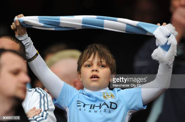 Barclays Premier League Arsenal v Manchester City Emirates Stadium A young Manchester City fan waves a club scarf in the stands