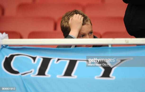 Barclays Premier League Arsenal v Manchester City Emirates Stadium A young Manchester City fan sits dejected in the stands