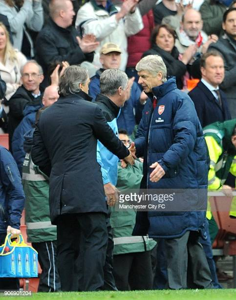 Barclays Premier League Arsenal v Manchester City Emirates Stadium Manchester City manager Roberto Mancini and Arsneal manager Arsene Wenger shake...