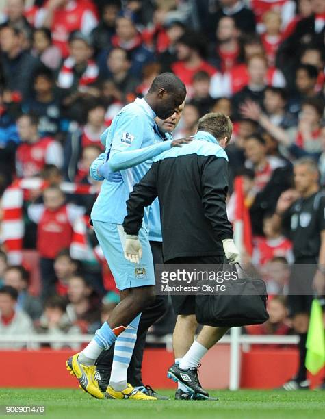 Barclays Premier League Arsenal v Manchester City Emirates Stadium Manchester City's Gnegneri Toure Yaya is helped off the pitch before he is...