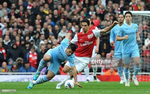 Barclays Premier League Arsenal v Manchester City Emirates Stadium Manchester City's Sergio Aguero and Arsenal's Mikel Arteta battle for the ball