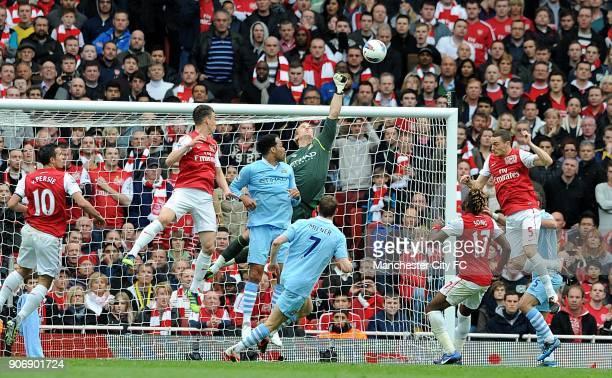 Barclays Premier League Arsenal v Manchester City Emirates Stadium Manchester City goalkeeper Joe Hart tips the ball away from goal