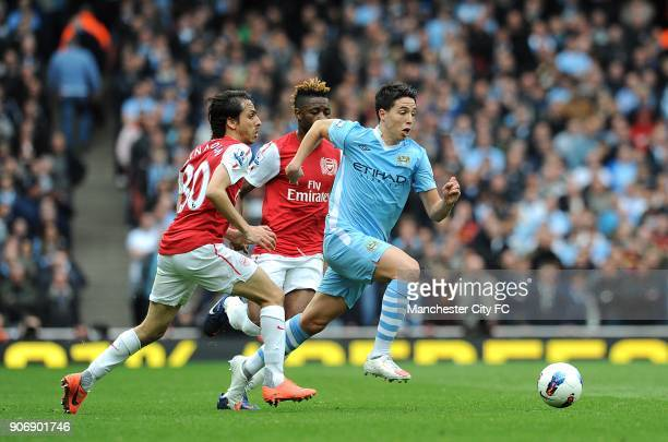 Barclays Premier League Arsenal v Manchester City Emirates Stadium Manchester City's Samir Nasri gets away from Arsenal's Alex Song and Yossi...