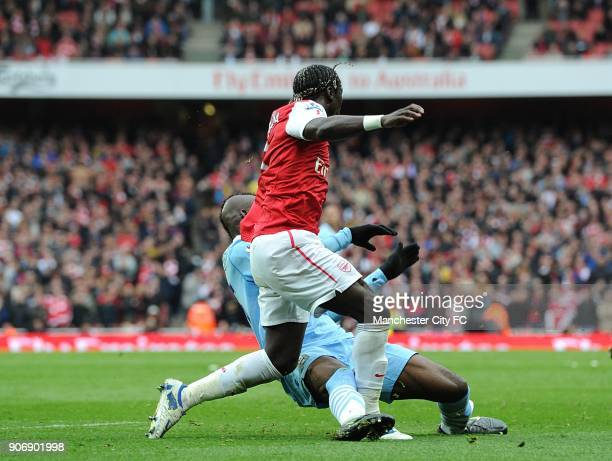 Barclays Premier League Arsenal v Manchester City Emirates Stadium Manchester City's Mario Balotelli fouls Arsenal's Bacary Sagna to earn himself a...