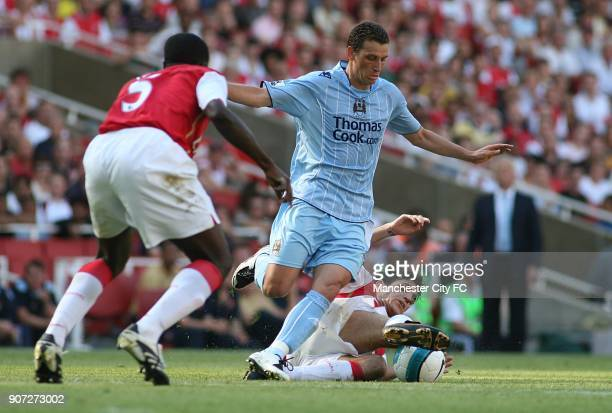 Barclays Premier League Arsenal v Manchester City Emirates Stadium Manchester City's Blumer Elano is challenged by Arsenal's Francesc Fabregas as...