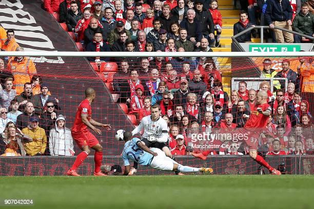 Barclays Premier League Liverpool v Manchester City Anfield Manchester City's Fernandinho takes a shot against Liverpool's goalkeeper Simon Mignolet