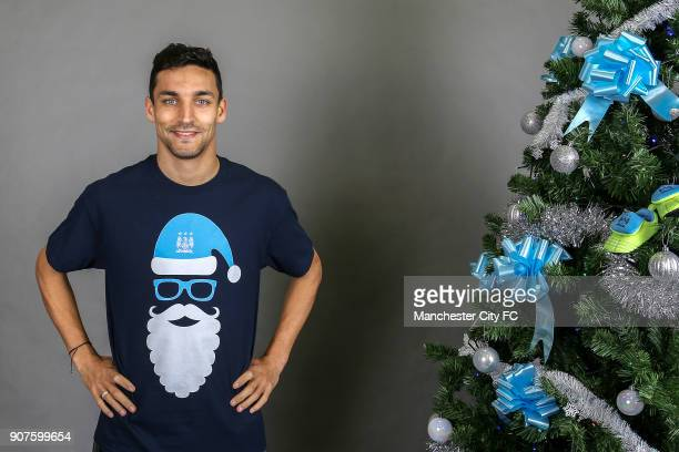 Barclays Premier League Manchester City Christmas Photo Manchester City's Jesus Navas poses wearing an official Manchester City Christmas tshirt