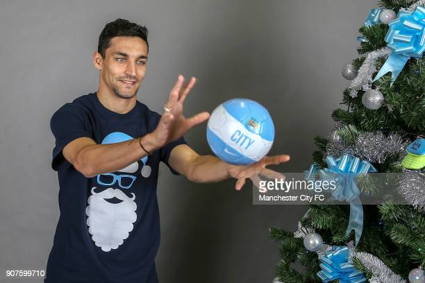 Barclays Premier League Manchester City Christmas Photo Manchester City's Jesus Navas poses with an official Manchester City football