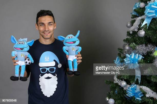 Barclays Premier League Manchester City Christmas Photo Manchester City's Jesus Navas poses with official Manchester City mascot cuddly toys