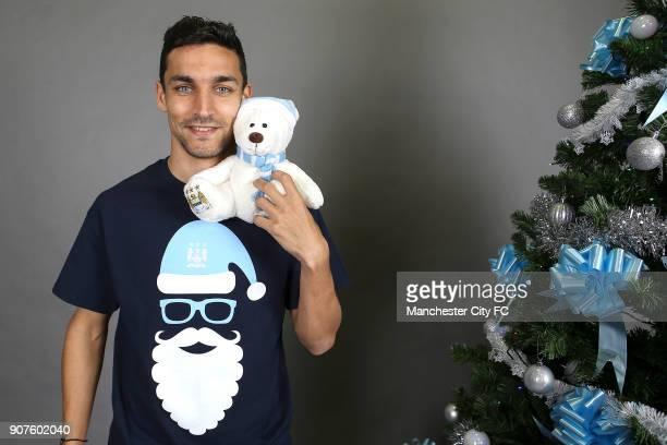 Barclays Premier League Manchester City Christmas Photo Manchester City's Jesus Navas poses wearing an official Manchester City Christmas teddy bear