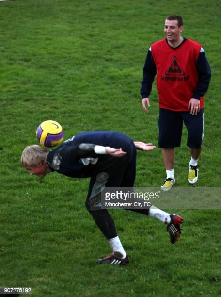 Barclays Premier League, Manchester City Training, Carrington Training Centre, Manchester City's Elano watches on in amusement as Kasper Schmeichel...
