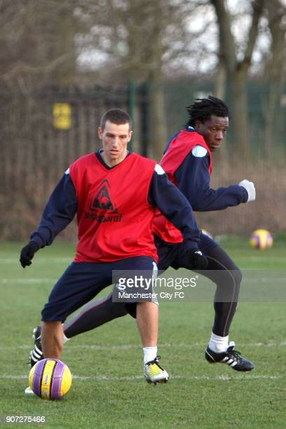 Barclays Premier League Manchester City Training Carrington Training Centre Manchester City's Richard Dunne adn Benjani Mwaruari in action