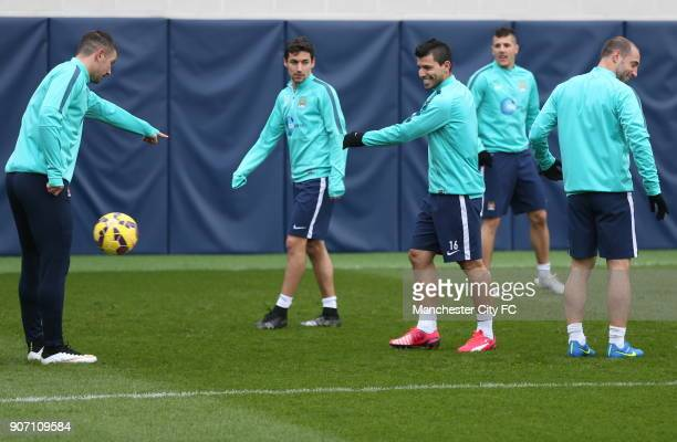 Barclays Premier League Manchester City Training City Football Academy LR Manchester City's Aleksandar Kolarov Jesus Navas Sergio Aguero Stevan...