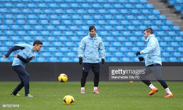Barclays Premier League Manchester City Training Etihad Stadium LR Manchester City's Jesus Navas Sergio Aguero and Alvaro Negredo during training