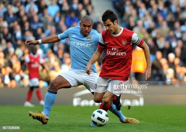 Barclays Premier League Manchester City v Arsenal City of Manchester Stadium Arsenal's Francesc Fabregas and Manchester City's Nigel De Jong battle...