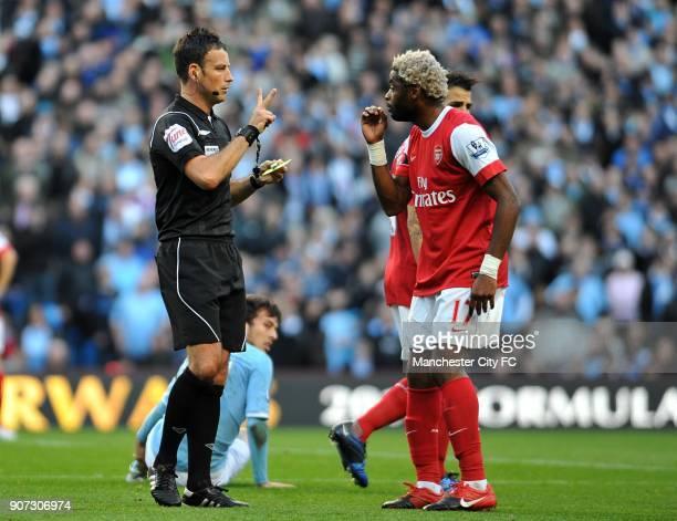 Barclays Premier League Manchester City v Arsenal City of Manchester Stadium Referee Mark Clattenburg talks to Arsenal's Alex Song