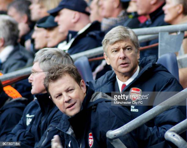 Barclays Premier League Manchester City v Arsenal Eastlands Arsenal's manager Arsene Wenger and Colin Lewin watch the action from the bench