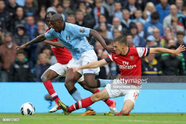 Barclays Premier League Manchester City v Arsenal Etihad Stadium Manchester City's Yaya Toure gets away from Arsenal's Aaron Ramsey and Gervinho