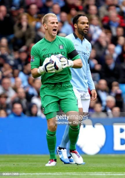 Barclays Premier League Manchester City v Arsenal Etihad Stadium Manchester City goalkeeper Joe Hart with teammate Joleon Lescott