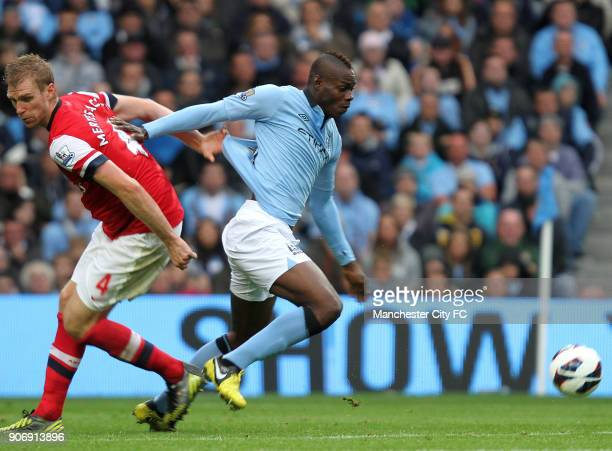 Barclays Premier League Manchester City v Arsenal Etihad Stadium Manchester City's Mario Balotelli gets away from Arsenal's Per Mertesacker