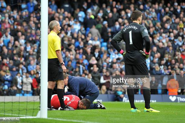 Barclays Premier League Manchester City v Arsenal Etihad Stadium Arsenal's Laurent Koscielny lies injured
