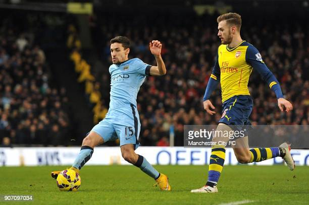 Barclays Premier League Manchester City v Arsenal Etihad Stadium Manchester City's Jesus Navas is chased for possession by Arsenal's Aaron Ramsey