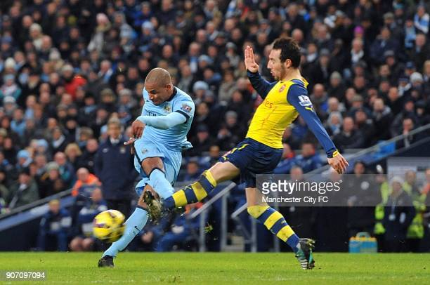 Barclays Premier League Manchester City v Arsenal Etihad Stadium Manchester City's Fernando and Arsenal's Santi Cazorla battle for the ball