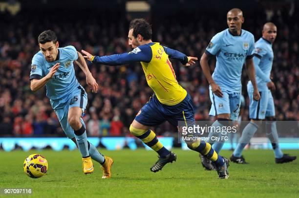 Barclays Premier League Manchester City v Arsenal Etihad Stadium Manchester City's Jesus Navas and Arsenal's Santi Cazorla battle for the ball