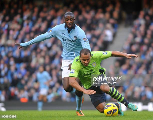 Barclays Premier League Manchester City v Aston Villa Etihad Stadium Aston Villa's Gabriel Agbonlahor and Manchester City's Yaya Toure battle for the...