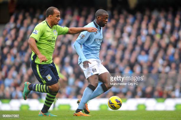 Barclays Premier League Manchester City v Aston Villa Etihad Stadium Manchester City's Yaya Toure and Aston Villa's Gabriel Agbonlahor battle for the...