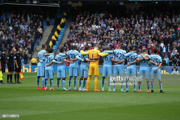 Barclays Premier League Manchester City v Aston Villa Etihad Stadium Manchester City players observe a minute's silence held for Bradford City fire...