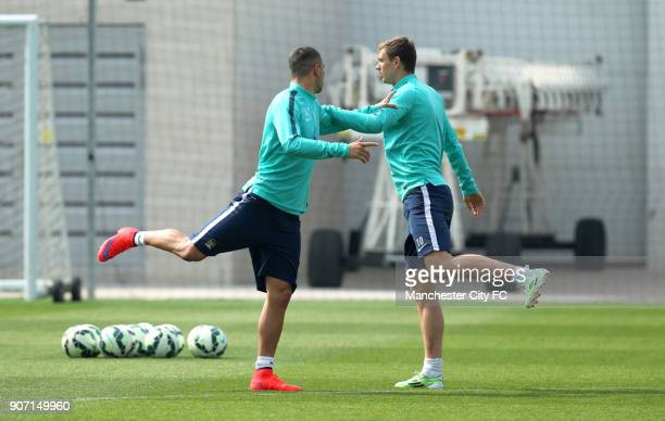 Barclays Premier League Manchester City v Aston Villa Manchester City Training City Football Academy Manchester City's Aleksandar Kolarov and Edin...