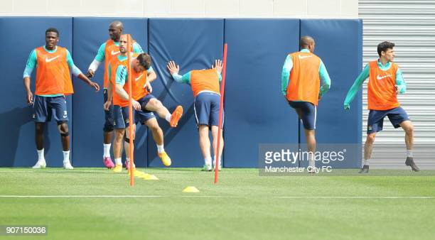 Barclays Premier League Manchester City v Aston Villa Manchester City Training City Football Academy Manchester City players stretch out during...