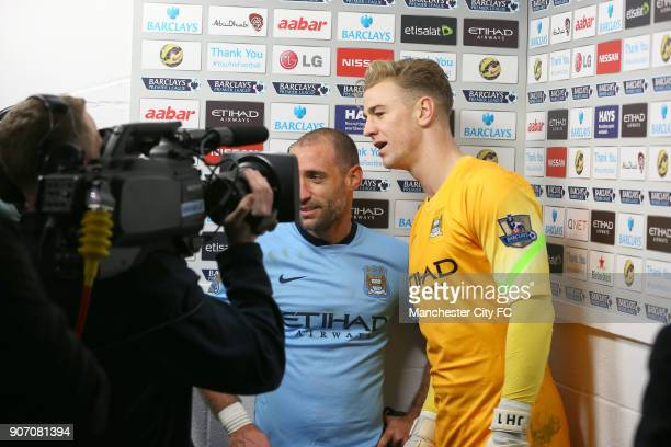Barclays Premier League Manchester City v Crystal Palace Etihad Stadium Manchester City goalkeeper Joe Hart is interviewed with teammate Pablo...