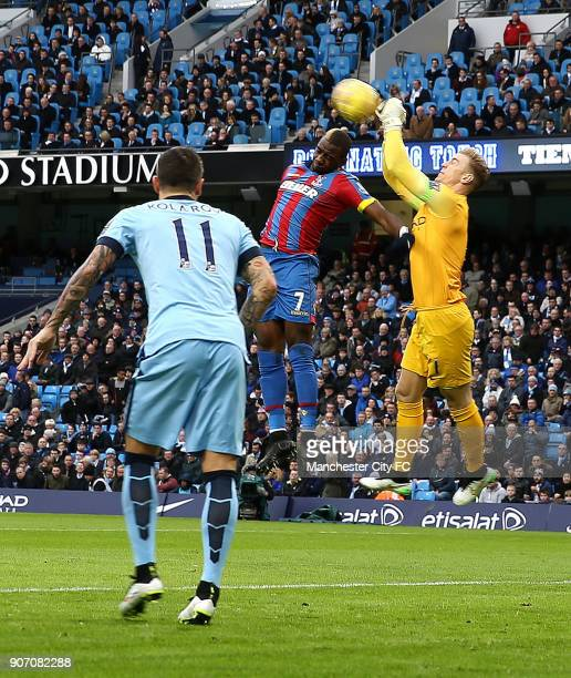 Barclays Premier League Manchester City v Crystal Palace Etihad Stadium Manchester City goalkeeper Joe Hart punches the ball of the head of Crystal...