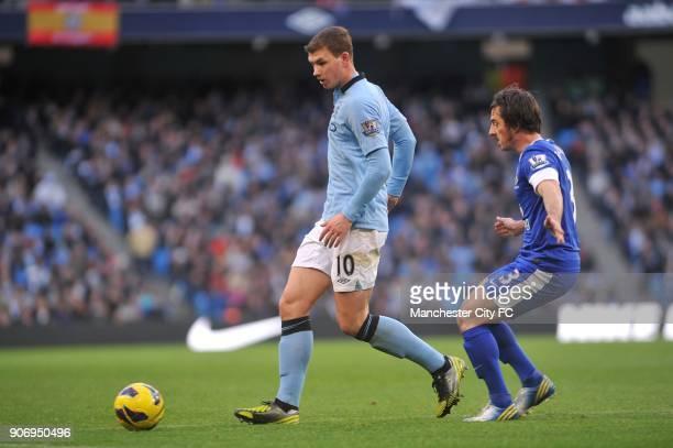 Barclays Premier League Manchester City v Everton Etihad Stadium Everton's Leighton Baines and Manchester City's Edin Dzeko battle for the ball