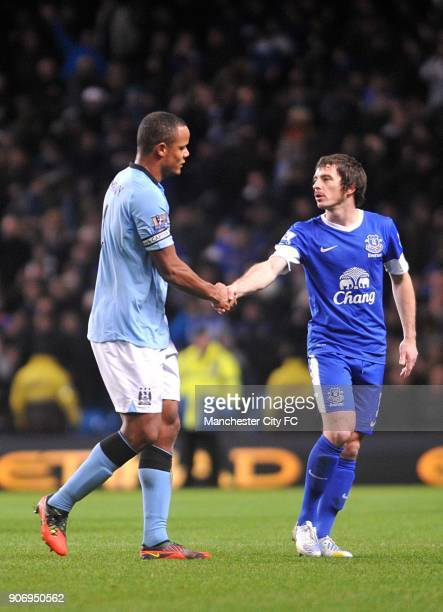 Barclays Premier League Manchester City v Everton Etihad Stadium Everton's Leighton Baines shakes hands with Manchester City's Vincent Kompany after...