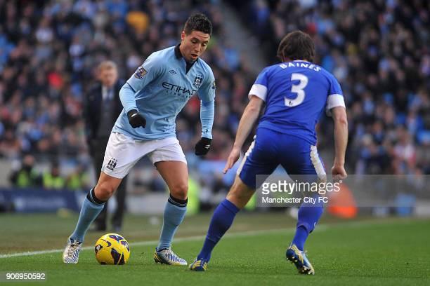 Barclays Premier League Manchester City v Everton Etihad Stadium Manchester City's Samir Nasri battles for the ball with Everton's Leighton Baines