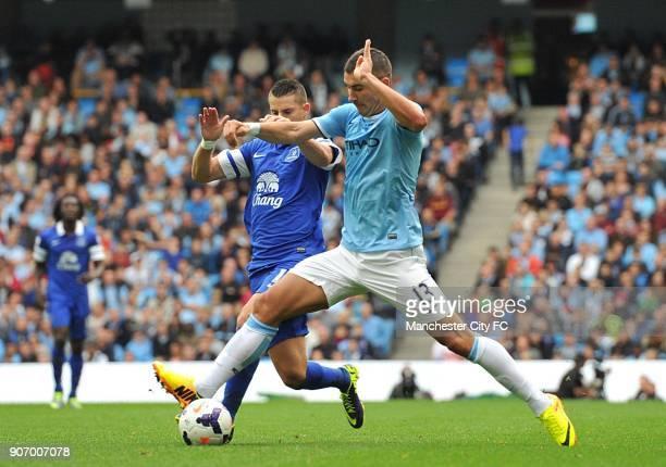 Barclays Premier League Manchester City v Everton Etihad Stadium Manchester City's Aleksandar Kolarov and Everton's Kevin Mirallas battle for the ball