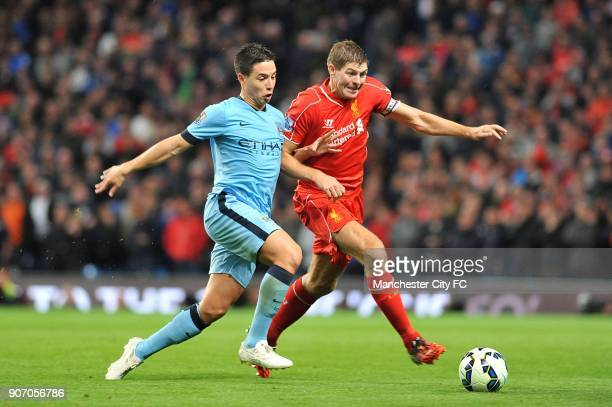 Barclays Premier League Manchester City v Liverpool Etihad Stadium Manchester City's Samir Nasri and Liverpool's Steven Gerrard battle for the ball